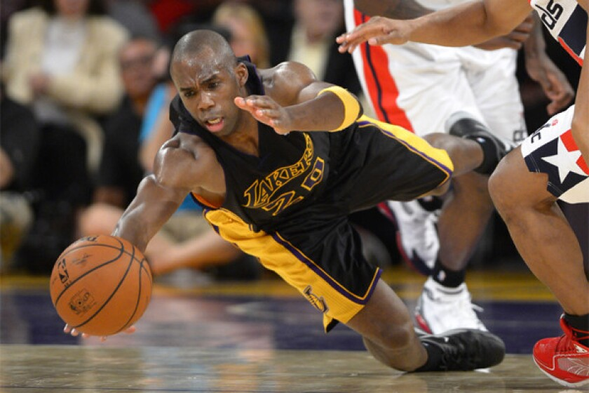 The Lakers' Jodie Meeks dives for a loose ball against Washington in March.