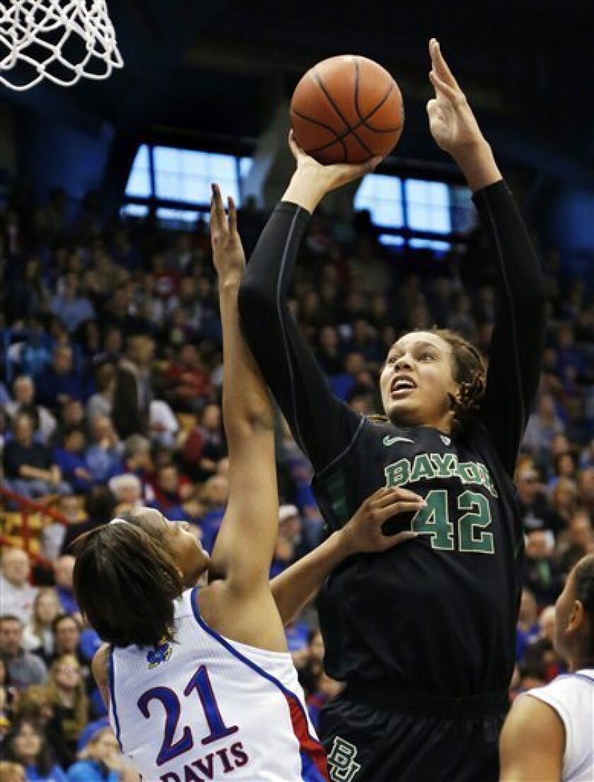 Baylor center Brittney Griner (42) shoots over Kansas forward Carolyn Davis (21) during the first half of an NCAA college basketball game in Lawrence, Kan., Sunday, Jan. 13, 2013. (AP Photo/Orlin Wagner)