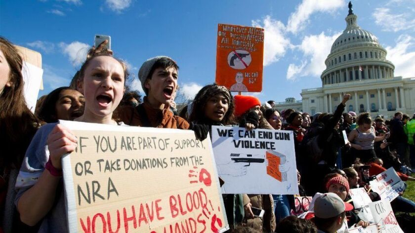 Students participate in a rally calling for more gun control outside the Capitol building in Washington on March 14.