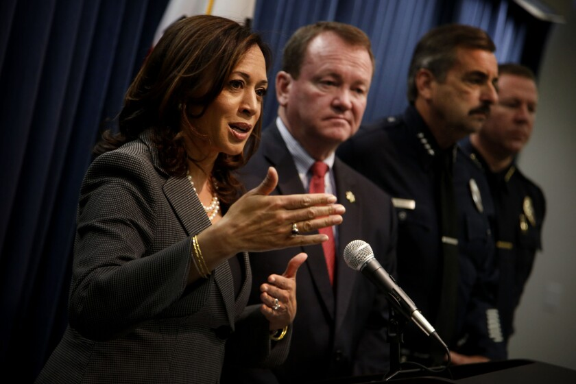California Atty. Gen. Kamala Harris discussed steps to prevent police bias at a news conference Friday in her downtown Los Angeles office with Los Angeles County Sheriff Jim McDonnell and LAPD Chief Charlie Beck.