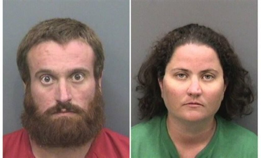 These photos provided by Hillsborough County Sheriff's Office show Joshua Michael Hakken, left, and Sharyn Hakken. Joshua Michael Hakken and his wife,Sharyn, are accused of kidnapping their two young sons and fleeing by boat to Cuba. They were handed over to the United States and their children were returned to the maternal grandparents who have official custody, authorities said Wednesday, April 10, 2013. The couple are being held at the Hillsborough County Jail on a number of charges includi