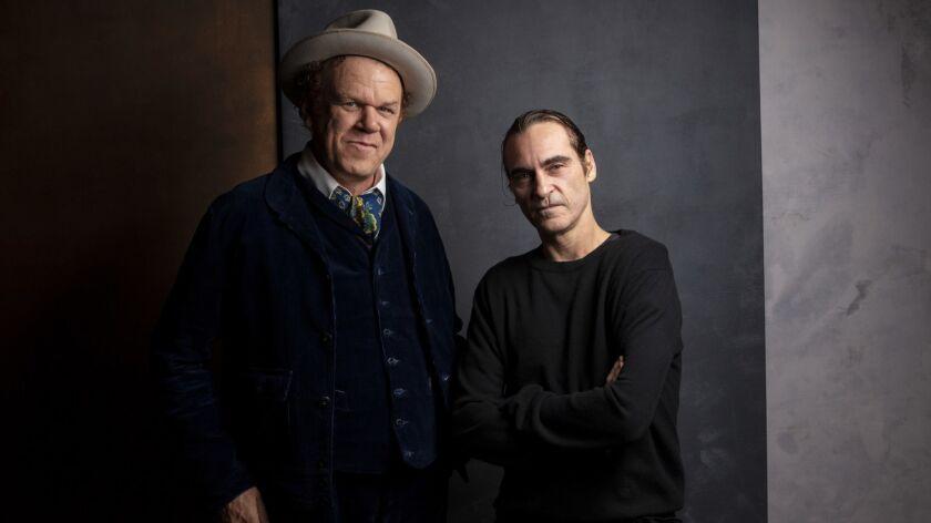 TORONTO, ONT., CA -- SEPTEMBER 09, 2018-- Actor/Producer John C. Riley, and actor Joaquin Phoenix, f
