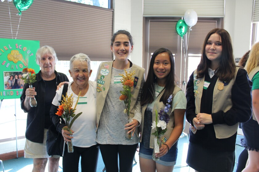 Rancho Santa Fe Girl Scouts Maira Clotfelter, Chloe Luwa and Jewel Perry connected with local seniors on Friendship Day.