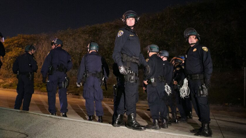 A new report looks at the number of law enforcement officers killed in the line of duty in 2014. Above, Los Angeles police at an Ezell Ford demonstration Monday on the 110 Freeway.