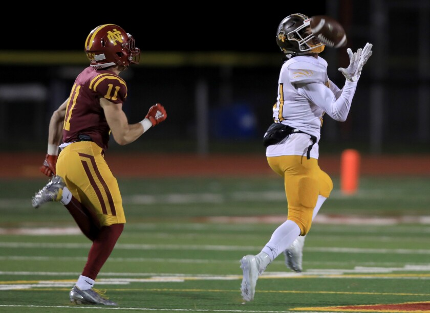 El Camino's Jacob Gathright hauls in a TD pass in last season's 3-AA CIF football championship game, won by Cardinal Newman.