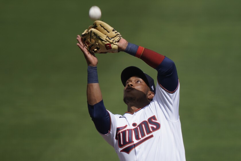 Minnesota Twins shortstop Jorge Polanco catches a fly ball in the second inning during a spring training baseball game against the Boston Red Sox on Sunday, Feb. 28, 2021, in Fort Myers, Fla. (AP Photo/Brynn Anderson)