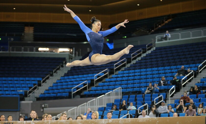 Kyla Ross, who won gold medal in the team competition at the 2012 Summer Olympics, performs on the balance beam during the UCLA gymnastics exhibition at Pauley Pavilion on Saturday.