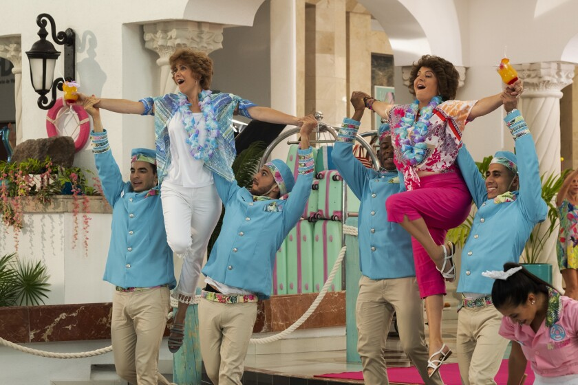 """Kristen Wiig and Annie are hoisted by hotel workers in """"Barb & Star Go to Vista Del Mar."""""""