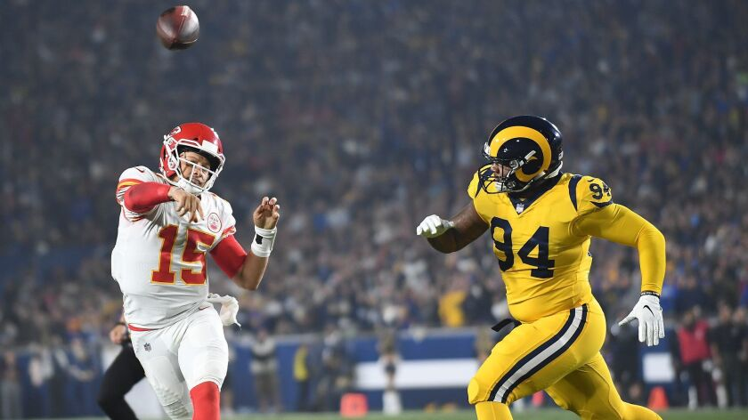 Chiefs quarterback Patrick Mahomes gets a pass off in front of Rams John Franklin-Myers in the second quarter at the Coliseum on Nov. 19, 2018.