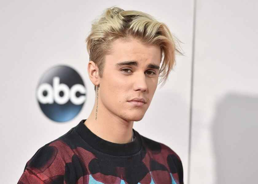 """FILE - In this Sunday, Nov. 22, 2015 file photo, Justin Bieber arrives at the American Music Awards at the Microsoft Theater in Los Angeles. A singer songwriter has sued Bieber and Skrillex for copyright infringement over their multi-platinum song, """"Sorry."""" Casey Dienel, who performs under the name White Hinterland, filed suit against the two performers as well as their publishing companies, Universal Music and co-writers in federal court in Nashville, Tennessee, on Wednesday, May 25, 2016, which claims that """"Sorry"""" uses a vocal riff from her song """"Ring the Bell."""" (Photo by Jordan Strauss/Invision/AP, File)"""