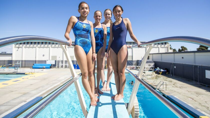 Members of the Marina High girls' diving team Aliya Babouset, 14, left, Maya Nugent, 15, Jenna Nelso