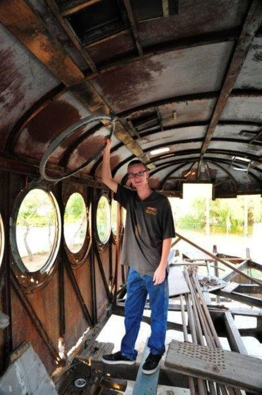 Madison Kirkman, 17, raised $16,000, much of it online, to bring this 1908 railroad car back to San Diego from Alaska and now plans to spend as much as $1 million to restore it into working order.