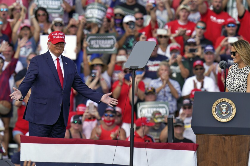 President Donald Trump gestures as he is introduced by first lady Melania Trump during a campaign rally Thursday, Oct. 29, 2020, in Tampa, Fla. (AP Photo/Chris O'Meara)