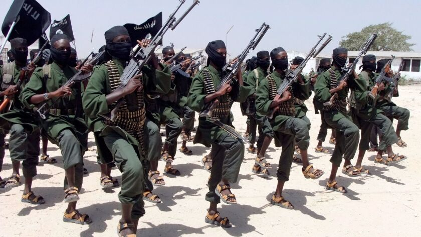 Hundreds of newly trained Shabab fighters perform military exercises south of Mogadishu in February 2011.