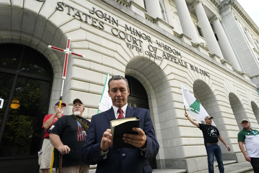Tony Spell, pastor of the Life Tabernacle Church of Central City, La., waits outside the Fifth Circuit Court of Appeals in New Orleans, Monday, June 7, 2021. Spell, who flouted coronavirus restrictions last year, prepared Monday to ask the court to revive his lawsuit challenging the restrictions. (AP Photo/Gerald Herbert)