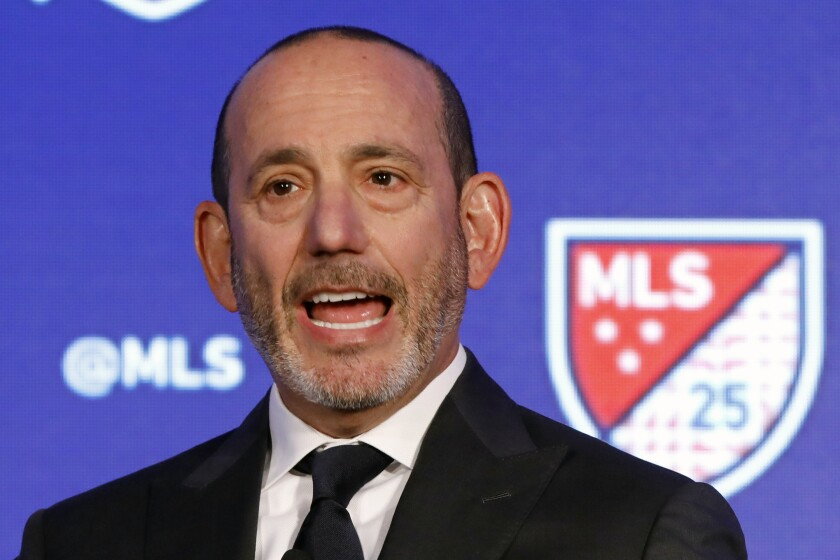 FILE - In this Feb. 26, 2020, file photo, Major League Soccer Commissioner Don Garber speaks during the Major League Soccer 25th Season kickoff event in New York. For Garber, a native New Yorker, Sept. 11 was not only emotionally wrenching on a personal level, it would test his resolve as commissioner just two years into the job. (AP Photo/Richard Drew, File)