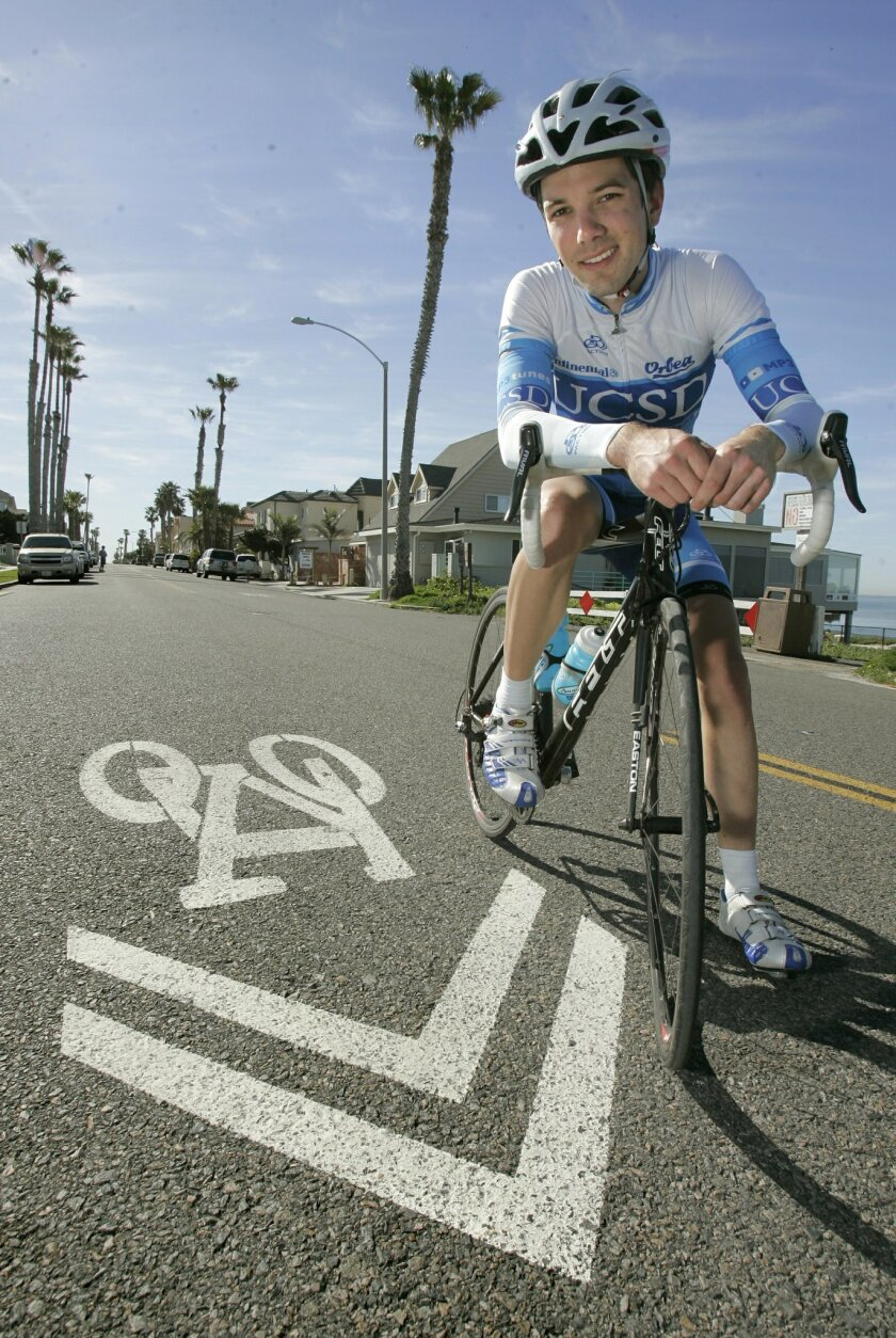 """UCSD student Trevor Haag with a """"sharrow"""" painted on Pacific Street in Oceanside, a narrow road that is popular with cyclists."""