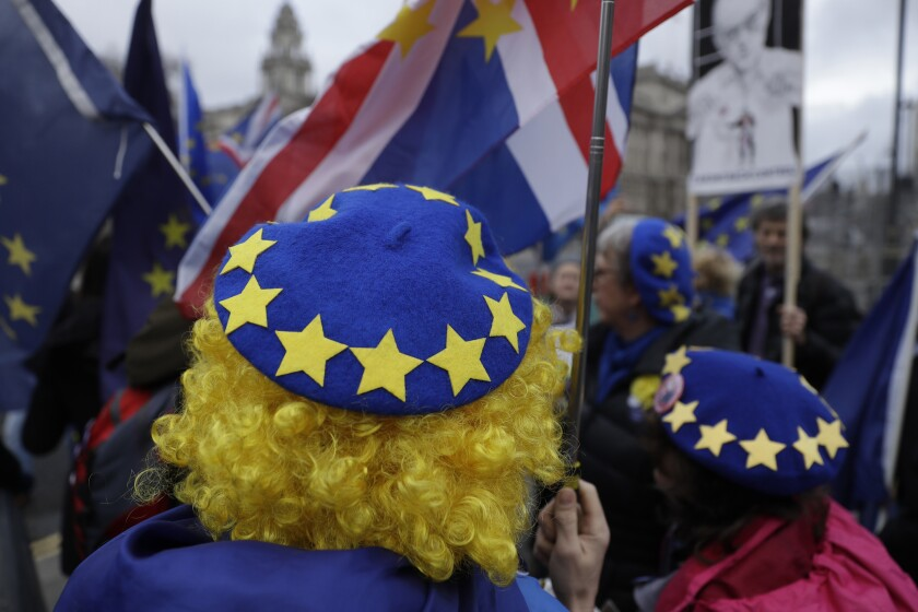 """FILE - In this file photo dated Wednesday, Jan. 8, 2020, pro-Europe protesters demonstrate against Britain's Brexit split from the Bloc, outside the Houses of Parliament in London. Millions of Europeans who have freely lived, worked and studied in the U.K. for decades, now have to apply to stay under the """"settlement"""" plan, but the deadline for applications is Wednesday June 30, 2021. From Thursday July 1, any European person who hasn't applied will lose their legal right to work, rent housing, access some welfare and hospital treatments in the U.K. and campaigners say many thousands may not have applied by the deadline. (AP Photo/Matt Dunham, FILE)"""