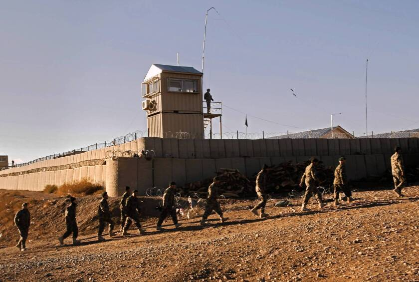 U.S., Afghan officials at odds over fate of military bases