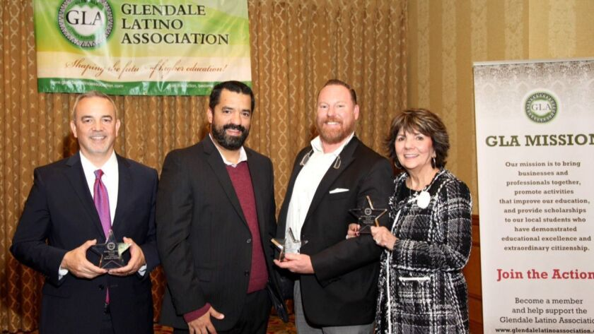 Glendale Latino Association honorees, from left, are Michael J. Garcia; Jenkins Properties Managemen