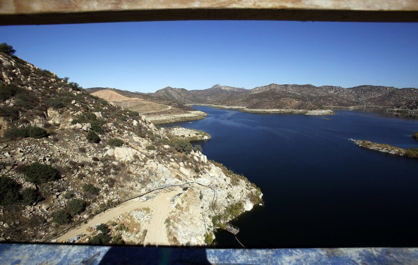 Framed by steel supports, the view of Lake San Vicente is breathtaking from the top of the dam.