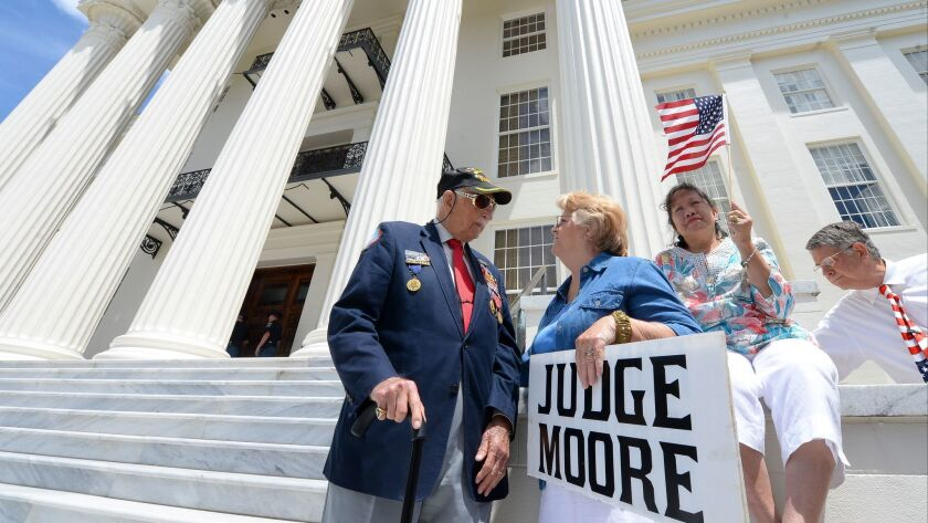 Supporters of suspended Alabama Chief Justice Roy Moore gather at the state Capitol in Montgomery t