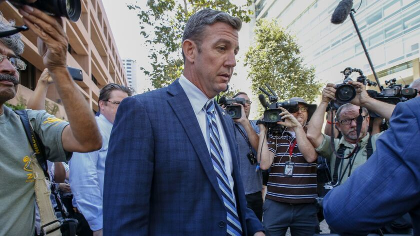 U.S. Rep. Duncan Hunter leaves a federal courthouse in San Diego after pleading not guilty to charges of illegally using his campaign account for personal expenses.