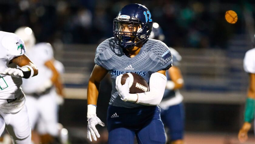 Otay Ranch running back Gus Espiritu ran for 102 yards and two touchdowns in the Mustangs' win over Lincoln.