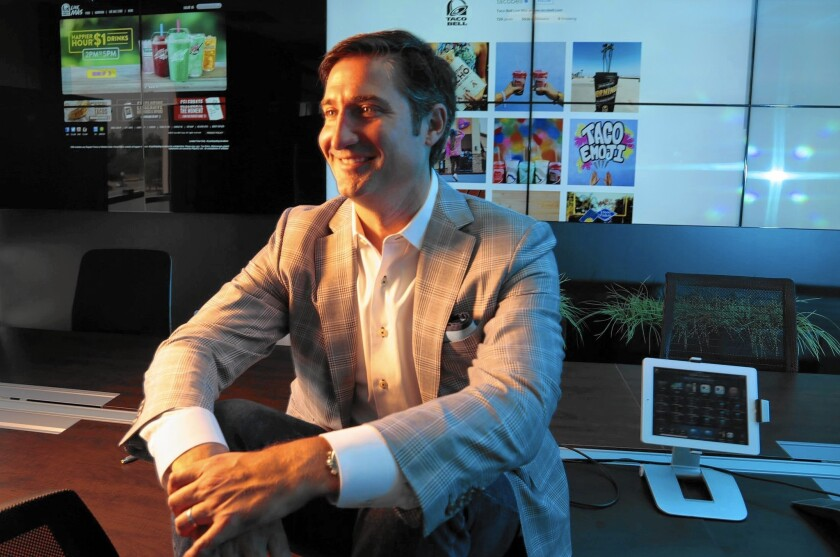 """Taco Bell chief Brian Niccol, above at company headquarters in Irvine, joined the fast-food chain in 2011 as its chief marketing and innovation officer. From the beginning, he said, he thought it was a brand with a """"youthful spirit that was ripe to unlock."""""""