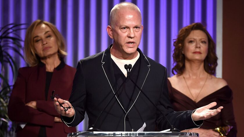 Jessica Lange, left, honoree Ryan Murphy and Susan Sarandon appear onstage during the Dec. 7 Hollywood power breakfast.