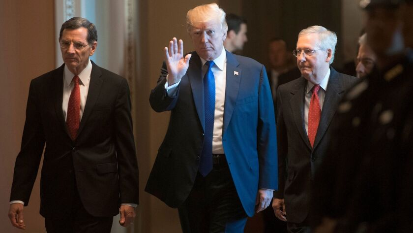 President Trump at Capitol Hill flanked by Sen. John Barrasso (R-Wyo.), left, and Senate Majority Leader Mitch McConnell (R-Ky.).