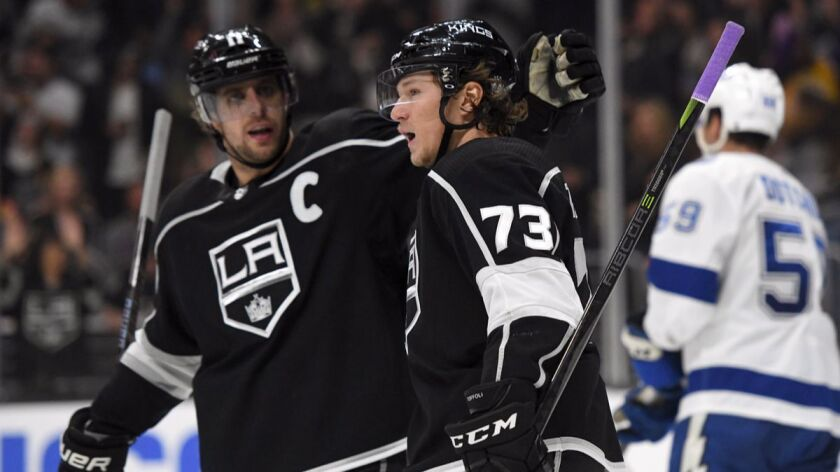 Kings center Tyler Toffoli (73) is congratulated by center Anze Kopitar after scoring against the Tampa Bay Lightning during the second period Nov. 9.