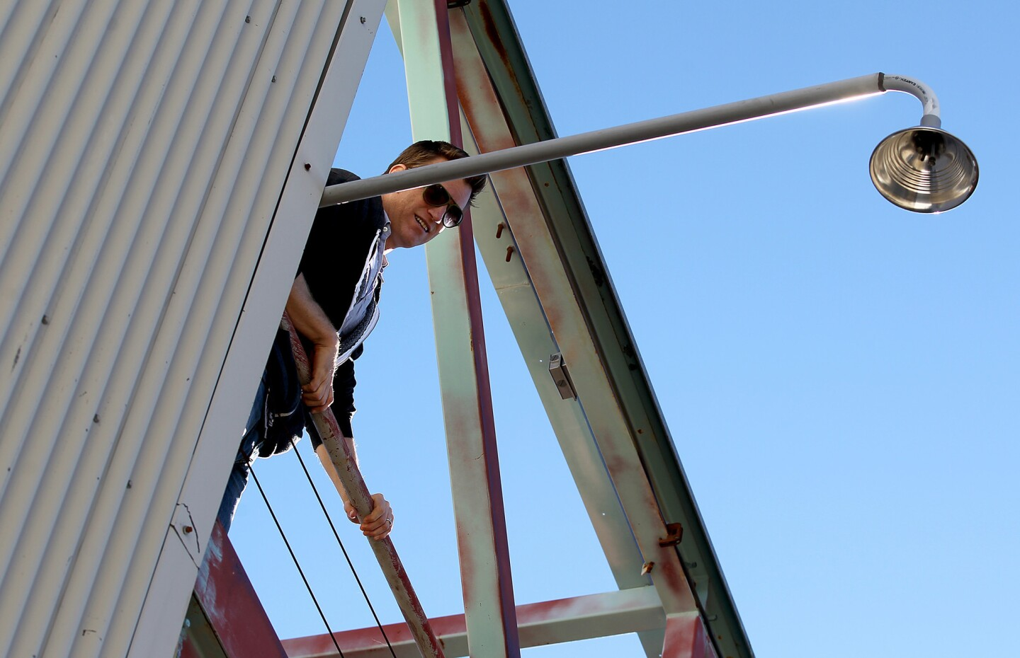 Scientist Ian Faloona checks an intake tube mounted on the exterior of Bernard M. Oliver Observing Station.