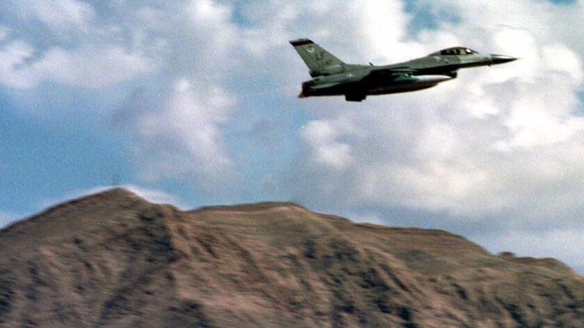 FILE––An F–16 fighter jet takes off from Nellis Air Force Base in this Aug. 10, 1999 file photo, tak