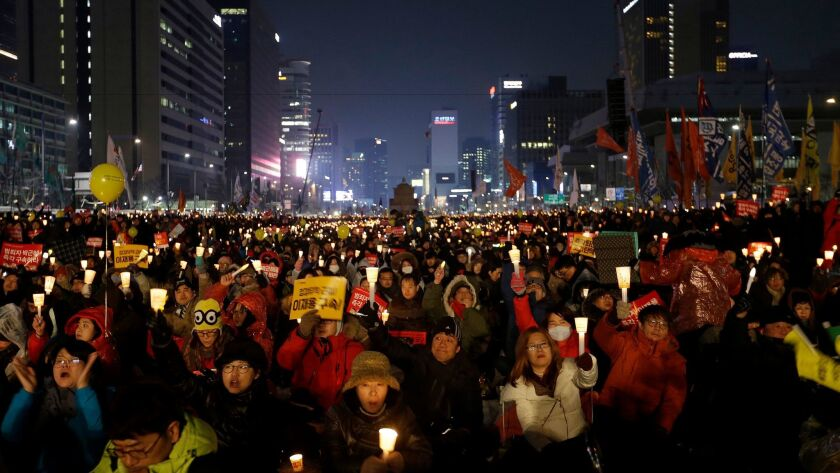 Protesters holding a candlelight vigil in Seoul on Jan. 21, 2017, call for impeached President Park Geun-hye to step down.