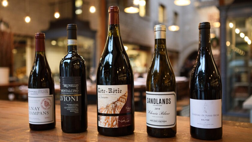 "From left: 2007 Domaine Marquis d'Angerville Volnay Champans, 2008 Salvioni Cerbaiola Brunello di Montalcino from Italy, 2009 Vignobles Levet Co™te-Ro™tie Les Journaries wine from France, Sandlands 2014 Chenin Blanc California and 2013 Cha‰teau Fosse-Seche Saumur ""Eolithe."""