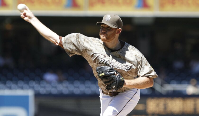 Padres starter Ian Kennedy delivers a pitch in the first inning Sunday against the Rockies.