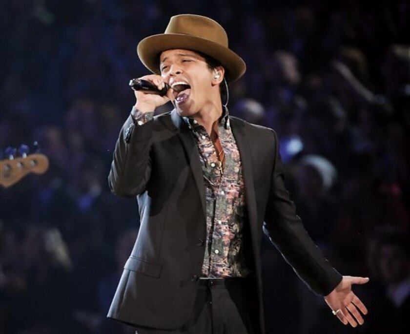 FILE - This Nov. 7, 2012 file photo shows Bruno Mars performing during the 2012 Victoria's Secret Fashion Show in New York. Billboard announced Wednesday, April 3, that Mars, Justin Bieber, Taylor Swift and R&B singer Miguel will perform at the Billboard Music Awards on May 19 in Las Vegas. (Photo