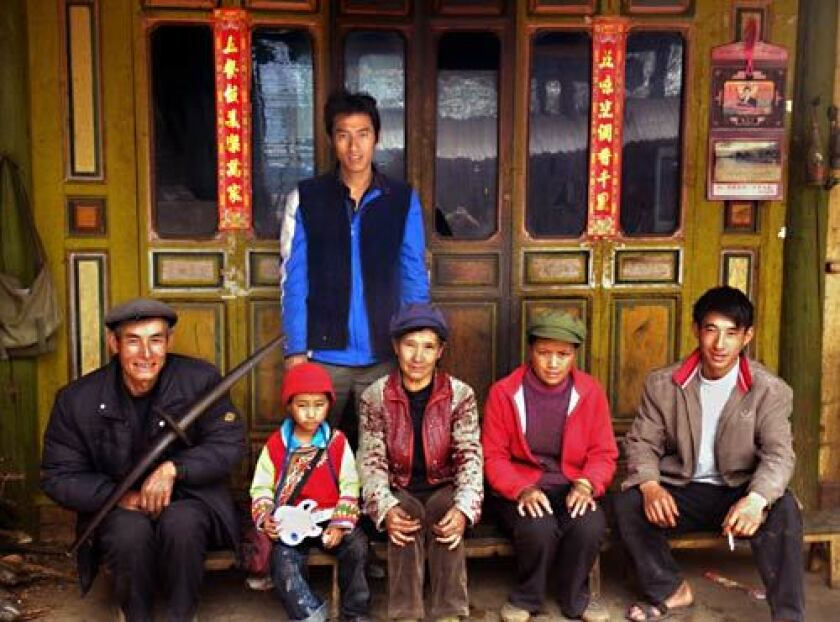 Nearly 8,000 members of the Lisu ethnic group, including this family, live inside Laojunshan.