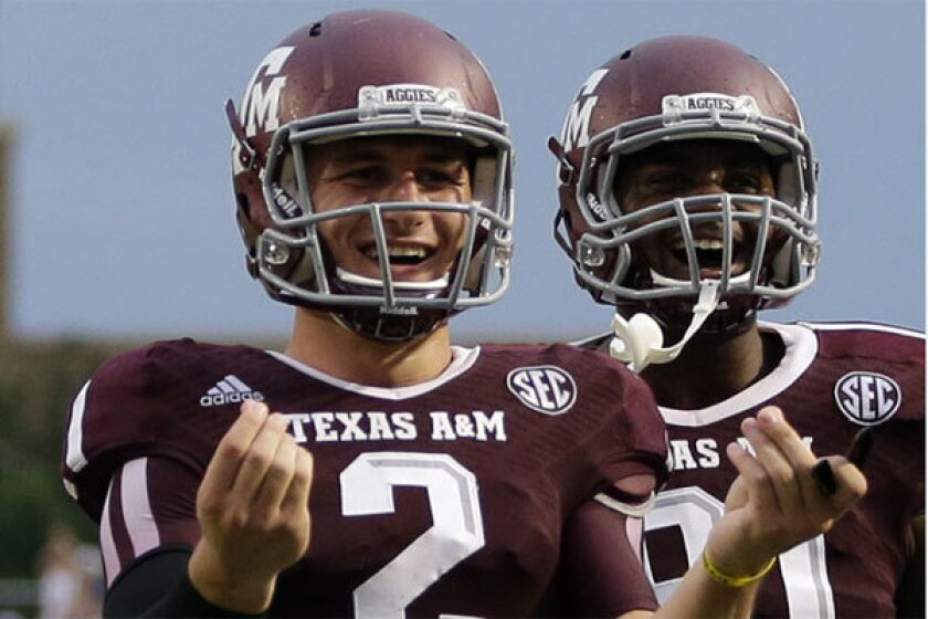 Texas A&M; quarterback Johnny Manziel celebrates after throwing a touchdown pass against Sam Houston State on Saturday.