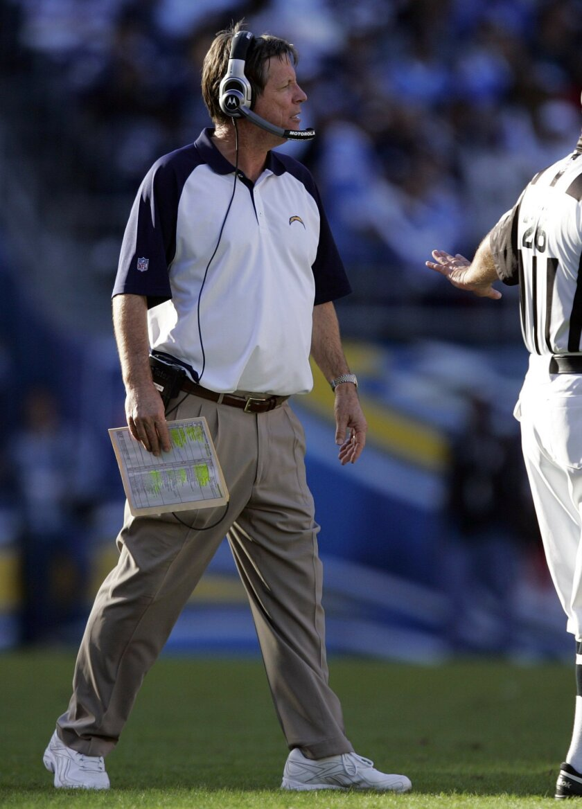 Chargers coach Norv Turner leaves the sideline to question an official during Sunday's game against Tennessee.