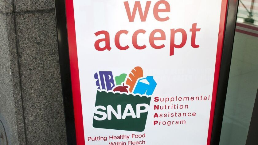 The final farm bill does not include House Republicans' controversial work requirements for able-bodied people receiving assistance through the Supplemental Nutrition Assistance Program, known as SNAP, or food stamps.