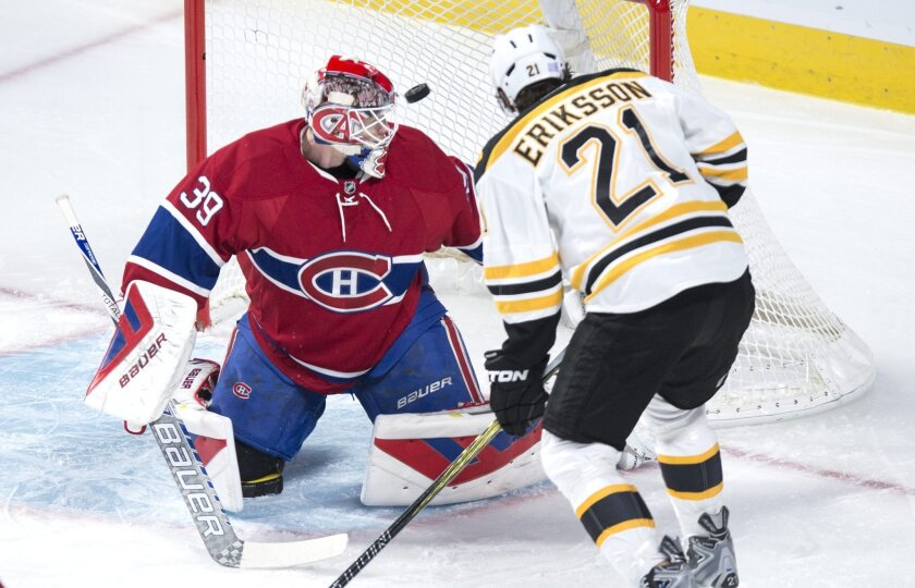 Boston Bruins' Loui Eriksson (21) scores a power play goal on Montreal Canadiens' goalie Mike Condon during first period NHL hockey action, in Montreal, on Saturday, Nov. 7, 2015. (Paul Chiasson/The Canadian Press via AP)