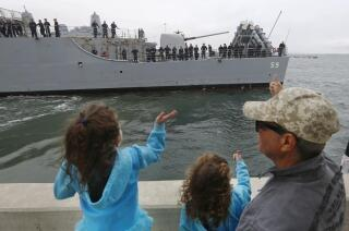 Navy flattop rides 'arc of history' to distant shores