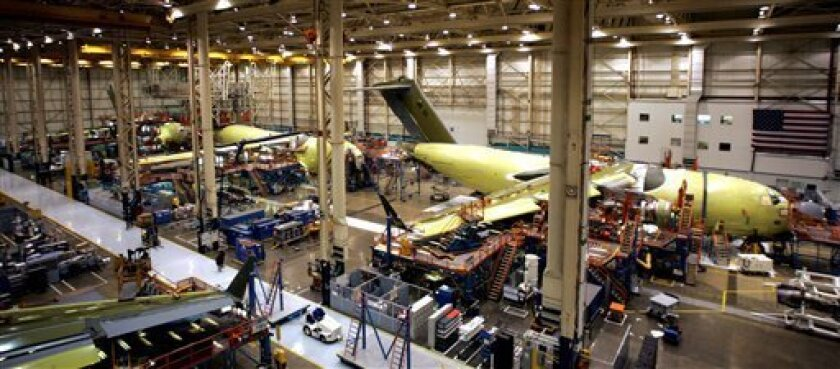 FILE - In this March 16 2006 file photo, the C-17 cargo plane assembly area is shown at the Boeing plant in Long Beach, Calif. There was excitement at Boeing's Long Beach C-17 assembly plant on Monday, June 6, 2011, after word that a $4 billion order from India for 10 of the giant cargo jets was hours away from two final signatures. (AP Photo/Stefano Paltera)