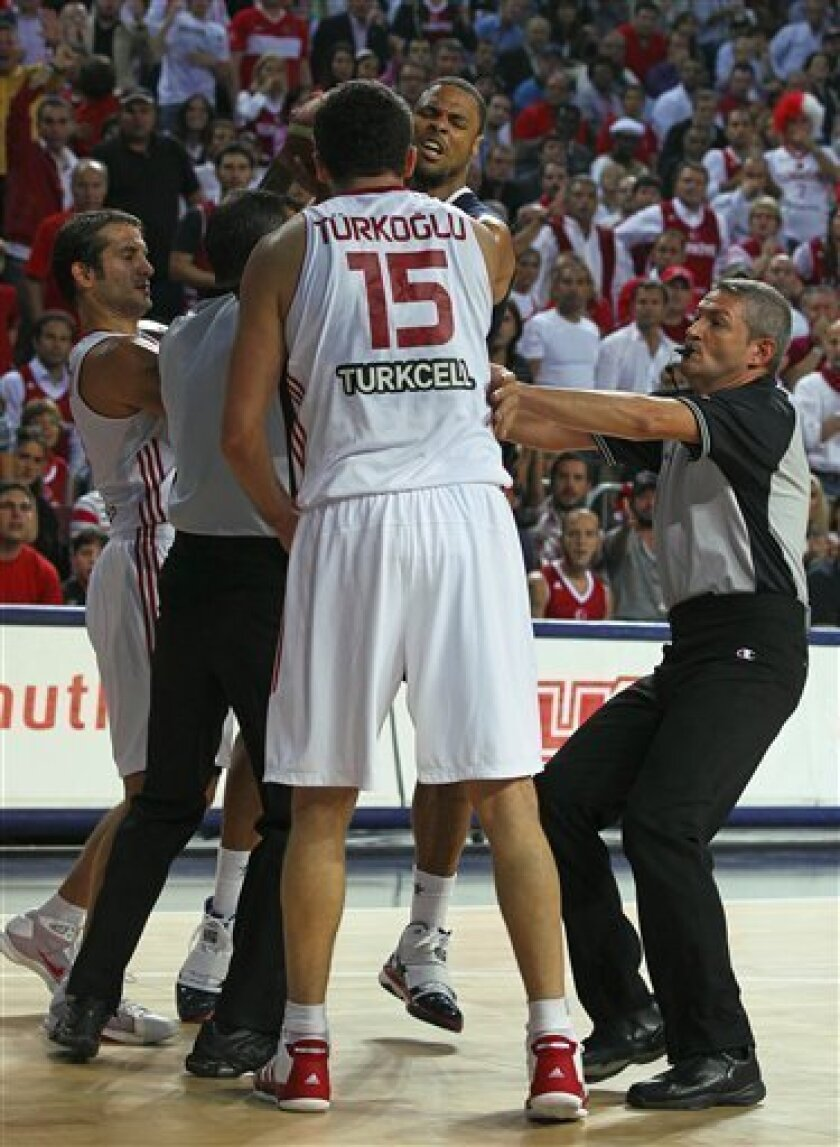 Referee Christiano Maranho, right, intervenes in a dispute between Turkey's Hidayet Turkoglu and USA's Tyson Chandler, facing at center, during the final of the World Basketball Championship between Turkey and the USA, Sunday, Sept. 12, 2010, in Istanbul. (AP Photo/Thanassis Stavrakis)