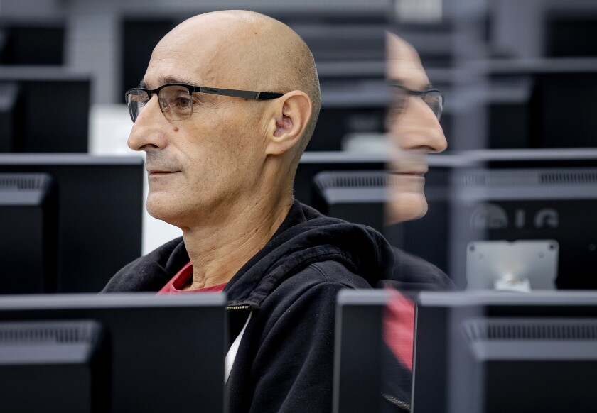 Salih Mustafa waits for the start of his trail at the Kosovo Specialist Chambers court in The Hague, Wednesday, Sept. 15, 2021. The first trial started at the Hague-based court of the former commander in the Kosovo Liberation Army charged with four war crimes including murder and torture. (Robin van Lonkhuijsen/Pool Photo via AP)