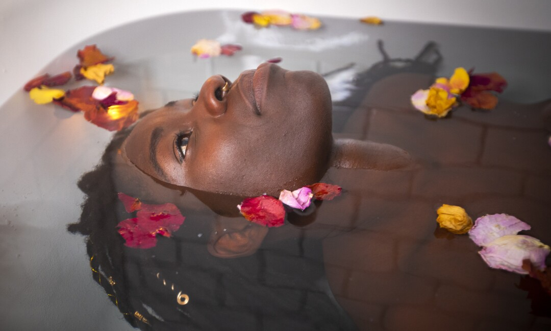 Alua Arthur takes a bath as a ritual, by soaking that includes candles, rose petals and epsom salt.
