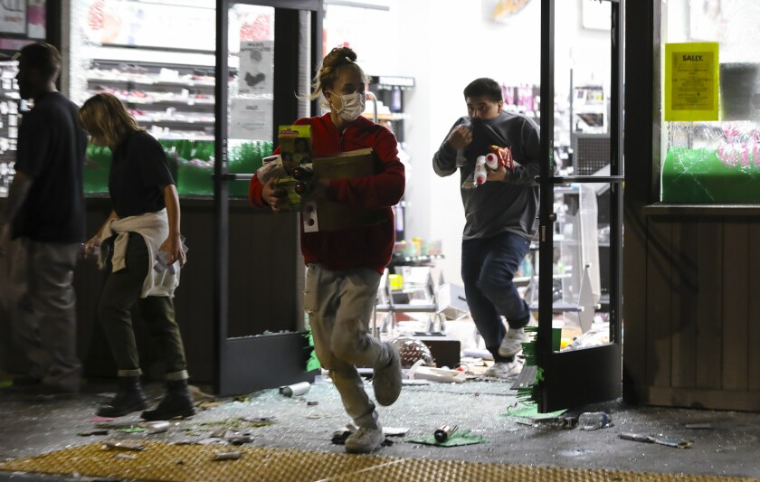 Several stores were looted at the La Mesa Springs shopping center Saturday night, including Sally Beauty Supply.