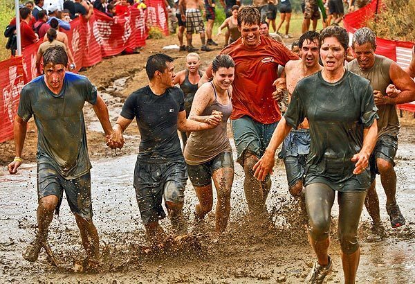 Competitors make their way through a puddle during the World Famous Mud Run at Camp Pendleton in Oceanside. Some runners said this year's course was tougher than last year's. See full story